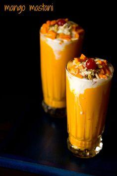 mango mastani drink - a popular dessert drink from pune. thick mango milkshake topped with vanilla or mango ice cream.