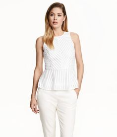 4a3f2f65aff Check this out! Sleeveless peplum top in graphic-patterned lace. Opening at  back