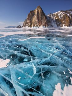 Frozen lake Baikal in Siberia. Perfect spot for winter landscape photography. #Baikal #Russia #Siberia  Photo by Yuri Pustovoy.