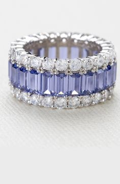 A circle has no end - just like the dazzle on this ring! No end in sight! Eternity bands are for those who never give up on shining for all time.   Tanzanite Simulant & White Dia Sim 11.25ctw Rhodium Plated Silver Ring