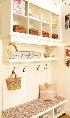 I love the layout of this mudroom- shelves for everything, and a cute bench!