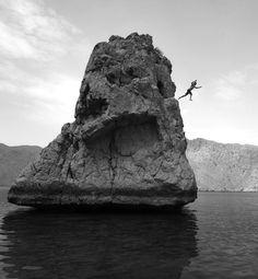 Rock jumping at Zighy Bay in Oman
