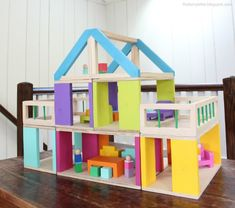 A DIY tutorial to buils a modular dollhouse and free plans for dollhouse furniture.