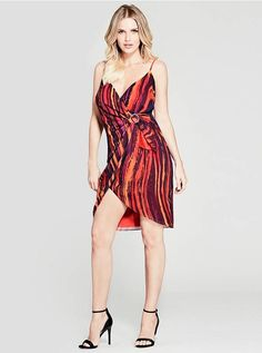 Vibrant colors pop on this lustrous wrap-front dress with adjustable shoulder straps, a paint stroke print and gold-tone buckle | MARCIANO.com