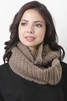 Cozy up with style with the Misty Knit Infinity Scarf. This infinity scarf features soft woven ribbed knit. 100% Polyester.