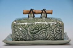 Ceramic green celadon butter dish with paisley texture and natural bamboo handle