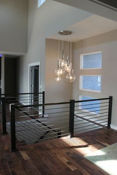 Modern stairwell with awesome light fixture