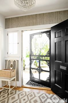 Modern Farmhouse Design Ideas - Modern Farmhouse Decorating - House Beautiful that is a great screen door that wouldn't ruin the front of the house.but the dogs & kids will ruin the screen door :-( Modern Farmhouse Design, Doors, Diy Screen Door, Home, House Styles, New Homes, Black Front Doors, House, Beautiful Homes