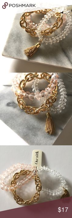 Bracelet set • gold and blush pink Brand new with tags, stretchy bracelet set in gold, clear and blush pink with a little gold tassel. Super cute!! One Wink Jewelry Bracelets