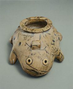 Egyptian frog-shaped jar, ca. 3400-3300 BCE; limestone inlaid with shell, lapis lazuli, and turquoise