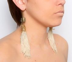 How absolutely HOT are these earrings!?!  I love all danlgy and tassle earrings- especially when worn with your hair up or a short pixie hair-cut.  So chic and sexy!   [uncovet-Dip Dyed Pyrite Earrings]