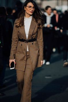 Really like the belt over the jacket. Also really love seeing a slim woman whose waist isn't the size of an average thigh. Milan Fashion Week Street Style 2017 | British Vogue