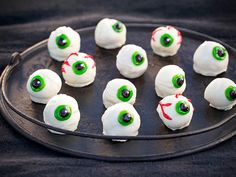 Use gel icing to decorate these lifelike eyeballs - they're really cake balls - with veins.