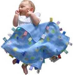 baby tag blanket. Oh my gosh, I needed one of these when Wyatt was a baby.  He LOVED the tag on his blankie.