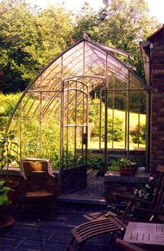 Wish I had a greenhouse :(...I love the shape of this one.