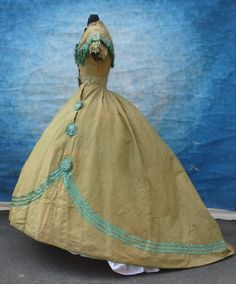 Sold on ebay for $650.00.  Vintage Victorian 1860's chartreuse green silk dress ball gown 2 bodices