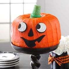 Jack-o'-Lantern Cake Recipe -I pieced two bundt cakes together to make this gap-toothed grinner that will make the best-ever centerpiece at your Halloween party. —Julianne Johnson, Grove City, Minnesota