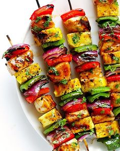 RAINBOW HAWAIIAN CHICKEN KABOBS Made by @gimmesomeoven  @gimmesomeoven  INGREDIENTS:  RAINBOW HAWAIIAN CHICKEN KABOBS INGREDIENTS: wooden or metal skewers 1.5 pounds boneless skinless chicken breasts, cut into bite-sized pieces 1 batch Hawaiian Teriyaki Sauce, divided (see below) 2 large green bell peppers, cored and cut into bite-sized pieces 2 large red bell peppers, cored and cut into bite-sized pieces 1 large pineapple, cored and cut into bite-sized pieces 1 large red onion, peeled and…