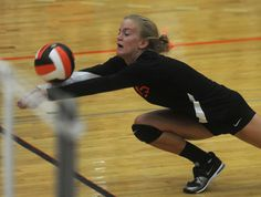 Ames' Lauren Eller dives for the ball against Des Moines North at Ames High School on Tuesday. Photo by Nirmalendu Majumdar/Ames Tribune   http://amestrib.com/sports/prep-volleyball-little-cyclones-flex-muscles-sweep-polar-bears