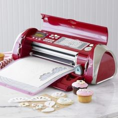 Cricut Cake Decorating Machine  $300 I wonder if it can do paper too, or just stuff for baking, hm...