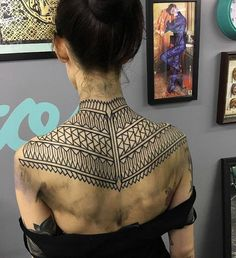 Geometric pattern by Kieran Williams.  http://tattooideas247.com/geometric-back-pattern/