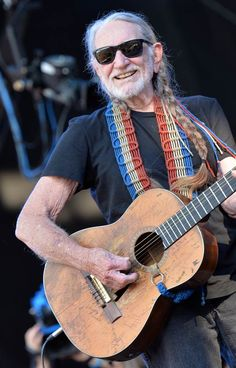 Musician Willie Nelson performs during the Oklahoma Twister Relief Concert to benefit United Way of Central Oklahoma May Tornadoes Relief Fund at Gaylord Family Oklahoma Memorial Stadium on July 6, 2014 in Norman, Oklahoma.