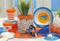 I love the orange and blue colors for a surf themed baby shower. And the little flip flops as decoration are adorable!