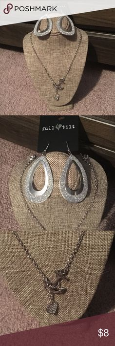 Full Tilt Jewelry Bundle Full Tilt Necklace and Earrings bundle  •NWT •Silver chain with anchor and heart charms. Silver glitter tear drop earrings (perfect for holiday accessorizing!)  •Perfect for a gift or a fun look •Bundle to save 10% / holiday shop with confidence Full Tilt Jewelry