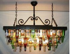 beer bottle chandelier.  not quite my style, but so clevah!