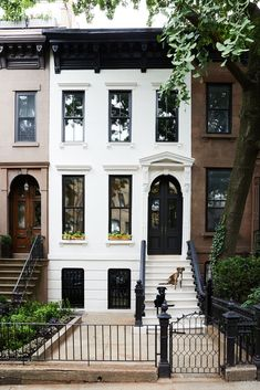 Photo 2 of 27 in Before & After: A Brooklyn Brownstone… Exterior, Flat RoofLine, House Building Type, and Metal Roof Material The original brownstone exterior was given a bright refresh with Farrow & Ball Skimming Stone paint on the facade and Brooklyn Brownstone, Brooklyn House, New York Brownstone, Exterior Paint, Exterior Design, Building Exterior, Black Exterior, Exterior Doors, Building Facade