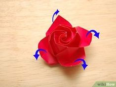 How to Fold a Paper Rose. Folding a rose is an intermediate origami project that results in a beautiful, decorative flower. It all starts with a simple square that's carefully folded into a spiral pattern. The rose comes together as four. Paper Rose Craft, Paper Folding Crafts, Origami Paper Folding, Rose Crafts, Paper Crafts, Kirigami Patterns, Origami Cards, Origami And Quilling, Origami Rose