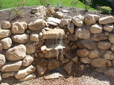 Waterfall nicely designed.  #waterfall #landscaping #yardideas #backyards #plants #shrubs #pavers #duvalllandscaping.com
