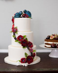 A three-tiered wedding cake adorned with lovebirds
