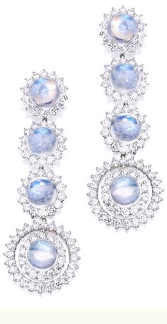 PAIR OF PLATINUM, MOONSTONE AND DIAMOND EARRINGS Set with eight cabochon moonstones weighing approximately 23.75 carats, accented by round diamonds weighing approximately 8.45 carats.