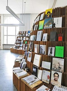 The UdK Bookshop was made from 600 corrugated-cardboard panels that were cut, folded and glued to create a lattice structure.