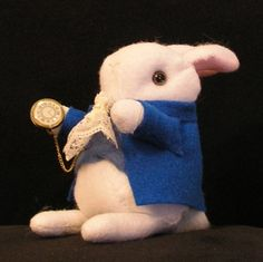 perfect!  cute but not too literal or bright disney colored!!!    http://www.etsy.com/listing/46592269/tardy-the-white-rabbit?ref=v1_other_2
