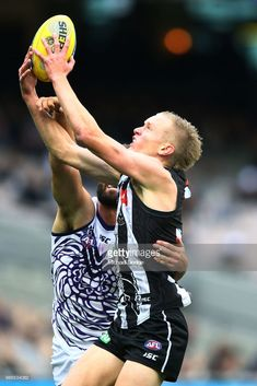 Jaidyn Stephenson of the Magpies marks the ball during the round 11 AFL match between the Collingwood Magpies and the Fremantle Dockers at Melbourne Cricket Ground on June 2018 in Melbourne, Australia. Collingwood Football Club, Melbourne Australia, White Man, Rugby, My Boys, Cricket, Goat, June, Fandoms