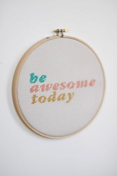 l i s t i n g ---    Sometimes you need a reminder. 7 wooden hoop, stitched with aqua/pink/gold thread on 14 count aida fabric with the words be awesome today. Comes ready to hang or can be propped up on a book shelf. --- g i f t w r a p ---    All hoop items can be gift wrapped with tissue and ribbon. I can also add a little to/from tag typed on my typewriter. Just leave a note to seller with the info! :)      --- m o r e i t e m s ---    Please take a look at my other items…