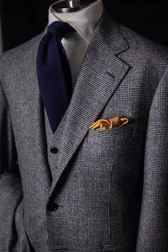 Classic Glen Check Tweed 3-piece suit paired with knit tie and pocket square