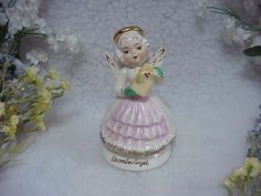 This is a cute vintage December girl birthday angel. She is wearing green gloves on her hands and she is holding a wrapped Christmas gift in her hands with holly and red berries on it. She is 4 inches high in excellent condition and is marked Japan on the bottom. She is a unique angel that we have never had before.. | eBay!