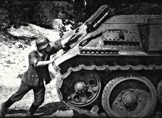 .German soldier trying to destroy a T-34 the hard way....with a Potato masher grenade attached to a Jerry can of gasoline..  A LOT OF GUTS. !