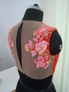 Beautiful machine floral embroidery on blouse.