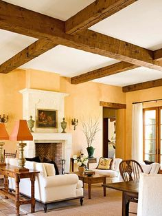 Color and Wood Tone: Choose Colors That Go Together. peacy/yellow walls rustic beams - PAINT COLOR Option for walls, to go with WOOD TRIM! Room Paint Colors, Paint Colors For Living Room, Yellow Walls Living Room, Home Design, Living Room Designs, Living Room Decor, Living Rooms, Dark Wood Trim, Kitchen Wall Colors