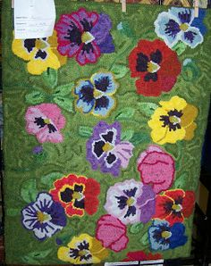 pansies...Sharon Smith pattern.  I've seen this hooked in several different color ways
