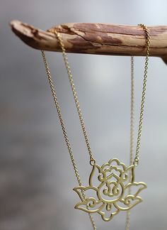 """Brushed Gold Lotus Flower Necklace. """"A beautiful lotus flower hidden in the forest """" @Madison Granvold @Haley Granvold"""