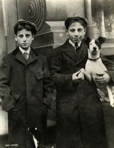 Gummo Marx, Groucho Marx, and dog.