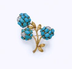 A TURQUOISE AND DIAMOND BROOCH, BY VAN CLEEF & ARPELS  Designed as cabochon turquoise flowers, enhanced by circular-cut diamond pistils and textured gold leaves, mounted in 18k gold, with French exportation marks Signed V.C.A for Van Cleef & Arpels, no. indistinct