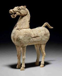 A RARE CARVED WOOD FIGURE OF A HORSE -  HAN DYNASTY (206 BC-AD 220)