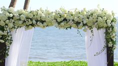 Blooms in shades of ivory and white covered the arch for a lush, dreamy garden effect.