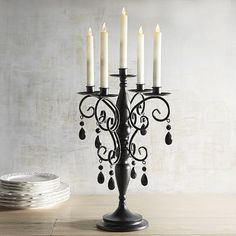 Bring a sense of dark elegance to your space with our jeweled candelabra that's…